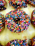 Chocolate Dipped Donuts with Sprinkles